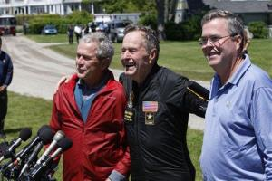 George HW Bush is joined by his sons George W. Bush and Jeb Bush as he speaks to reporters Friday, June 12, 2009, in Kennebunkport, Maine.