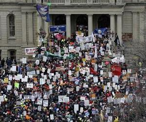 Protesters gather for a rally at the State Capitol in Lansing, Mich., Tuesday, Dec. 11, 2012.