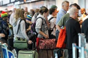 People wait in line at the security check point at the Portland International Airport Tuesday, July 3, 2012, in Portland, Ore.
