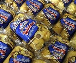 In this Friday, Nov. 16, 2012, file photo, Twinkies baked goods are displayed for sale at the Hostess Brands' bakery in Denver, Colo.