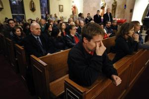 Mourners gather for a vigil service at the St. Rose of Lima Roman Catholic Church in Newtown, Conn., Friday.