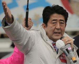 In this Dec. 15, 2012 photo, Japan's Liberal Democratic Party President Shinzo Abe speaks during a rally for Sunday's parliamentary elections near Tokyo.