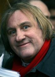 French actor Gerard Depardieu poses as his arrives in Paris, Wednesday, April 14, 2010.