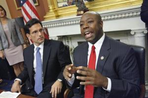 House Majority Leader Eric Cantor of Va. looks on at left as Rep. Tim Scott speaks about jobs, Monday, Sept. 12, 2011, on Capitol Hill in Washington.