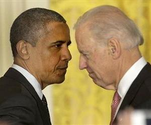 President Barack Obama passes Vice President Joe Biden in the White House in this file photo.