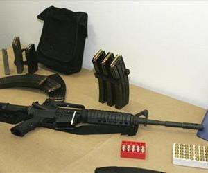 In this March 27, 2006 file photo, a Bushmaster AR-15 semi-automatic rifle and ammunition is seen at the Seattle Police headquarters in Seattle.