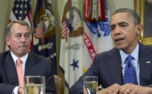 President Barack Obama, accompanied by House Speaker John Boehner of Ohio, speaks to reporters in the Roosevelt Room of the White House.