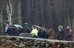 A woman, right, reacts during burial services for Noah Pozner, Monday, Dec. 17, 2012, in Monroe, Conn.