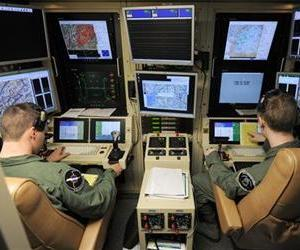 A student pilot and sensor operator man the controls of a MQ-9 Reaper in a ground-based cockpit during a training mission flown from Hancock Field Air National Guard Base, Syracuse, New York.