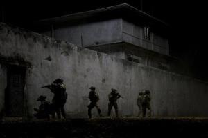 Navy SEALs raid Osama Bin Laden's compound in a scene from Zero Dark Thirty.