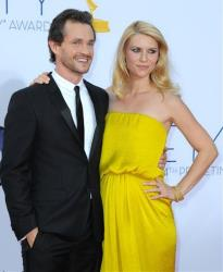 Actress Claire Danes, right and husband Hugh Dancy arrive at the 64th Primetime Emmy Awards at the Nokia Theatre on Sunday, Sept. 23, 2012, in Los Angeles.