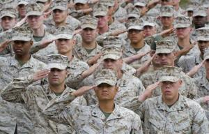 Marines salute prior to a medal-presentation ceremony at Camp Pendleton, Calif., in May.