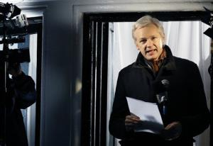 Julian Assange, founder of WikiLeaks speaks to the media and members of the public from a balcony at the Ecuadorian Embassy in London, Thursday, Dec. 20, 2012.