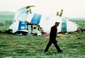 A police officer walks by the nose of Pan Am flight 103 in a field near the town of Lockerbie, Scotland where it lay after a bomb aboard exploded, in this December 21, 1988 file photo.