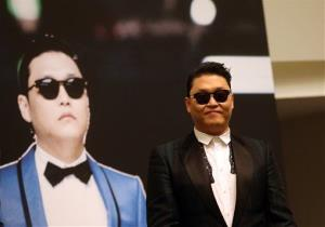 In this Dec. 1, 2012 file photo, South Korean rapper PSY, who gained popularity from his famous song Gangnam Style, gives a press conference prior to his concert at the Marina Bay Sands in Singapore.