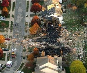 Two homes that were leveled and the numerous neighboring homes that were damaged from a massive explosion in Indianapolis are seen in this Nov. 11, 2012 aerial photo.