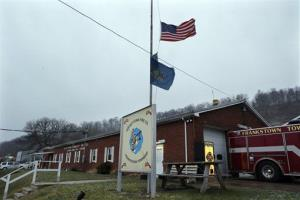 Flags fly at half staff for the victims of the Newtown, Conn., above the Geeseytown Fire Company, where members of the families of victims of another shooting gathered on Friday.