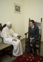 In this photo released by the Vatican newspaper L'Osservatore Romano, the pope visits with former butler Paolo Gabriele at the Vatican Saturday.