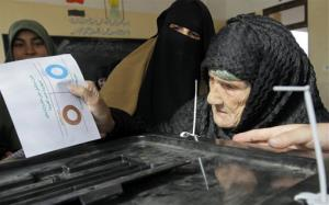Amnah Sayyed Moussa, 85, casts her vote for the second round of a referendum on a disputed Islamist constitution in Giza, Egypt, Saturday, Dec. 22, 2012.