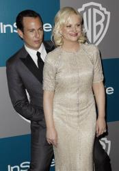 Will Arnett, left, and Amy Poehler arrive at the 2012 Warner Bros. and InStyle Golden Globe After Party at the Beverly Hilton in Los Angeles. on Sunday, Jan. 15, 2012.