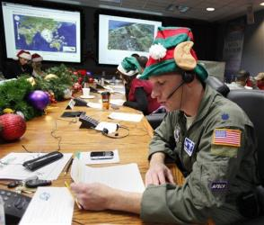 In this Dec. 24, 2010 file photo, Air Force Lt. Col. David Hanson takes a phone call from a child in Florida at the Santa Tracking Operations Center near Colorado Springs, Colo.