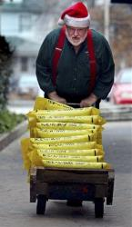 Roger McCreight, a hardware store employee, brings up bags of rock salt or customers Monday, in Maplewood, Mo., in anticipation of wintry weather.