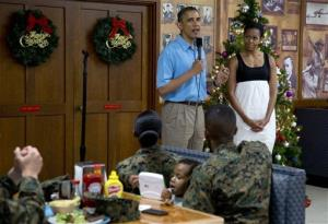 President Obama speaks  during a visit with members of the military and their families in Anderson Hall at Marine Corp Base Hawaii yesterday.