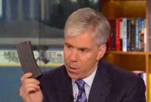 David Gregory holds what looks like a 30-round magazine on Meet the Press, Sunday, Dec. 23, 2012.