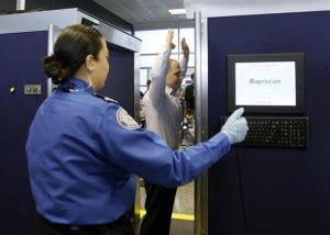 A TSA employee demonstrates the stance in an advanced image technology unit at Boston Logan International Airport, Friday, March 5, 2010, in Boston.