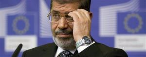 Egyptian President Mohamed Morsi gestures while speaking during a media conference at EU headquarters in Brussels on Thursday, Sept. 13, 2012.