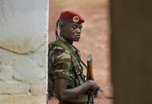 A soldier stands guard at a building used for meetings with US Army special forces, in Obo, Central African Republic, Sunday, April 29, 2012.