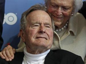 In this June 12, 2012 file photo, former President George HW Bush and his wife, Barbara, arrive for the premiere of HBO's new documentary about his life in Kennebunkport, Maine.