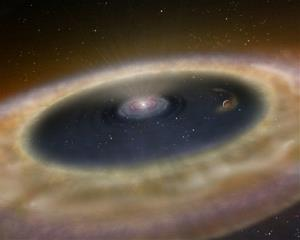 In an undated rendering provided by the University of Hawaii, a new planet forming around a star is seen. Several astronomers are predicting 2013 will be the year a true Earth-like planet is detected.