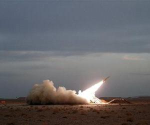 In this photo obtained from the Iranian Students News Agency, ISNA, a surface-to-air missile is fired by Iran's army, during a maneuver, in an undisclosed location in Iran, Tuesday, Nov. 13, 2012.