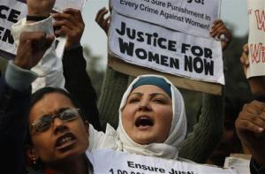 Indian women shout slogans as they protest against a recent gang-rape of a young woman in a moving bus in New Delhi, India, Thursday, Dec. 27, 2012.