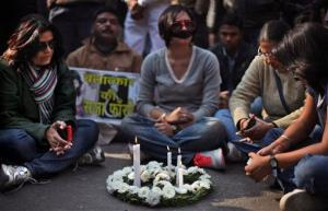 A wreath and candles are placed on a road as Indians mourn the death of a 23-year-old gang rape victim in New Delhi.