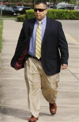 George Zimmerman walks into his hearing  at the Seminole County Courthouse, Friday, Oct. 19, 2012 in Sanford, Fla.
