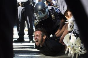 Occupy Wall Street protestor Chris Philips screams as he is arrested near Zuccotti Park, Monday, Sept. 17, 2012, in New York.