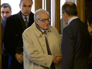 Russian Foreign Minister Sergey Lavrov, and UN envoy for Syria Lakhdar Brahimi, center, shake hands as they meet in Moscow, Russia, on Saturday, Dec. 29, 2012.