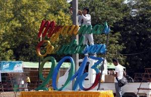 Workers prepare to set up a stage as preparations are underway for the country's first ever public New Year's countdown celebration, at Myoma grounds in Yangon, Burma, Monday, Dec. 31, 2012.