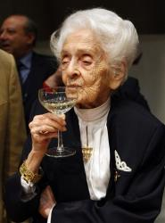 Italian neurologist and senator for life Rita Levi Montalcini, Nobel Prize winner for Medicine in 1986, seen with a glass, at the end of a press conference for her one hundredth birthday.