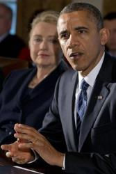Hillary Rodham Clinton listens as President Barack Obama makes a statement to the media before a meeting with his cabinet, Nov. 28, 2012, in the Cabinet Room at the White House in Washington.