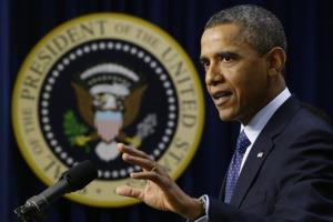 President Barack Obama gestures as he speaks about the fiscal cliff, Monday, Dec. 31, 2012, in the South Court Auditorium at the White House.