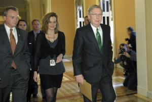 Senate Minority Leader Mitch McConnell of Ky. walks toward the Senate floor on Capitol Hill in Washington, Monday, Dec. 31, 2012.