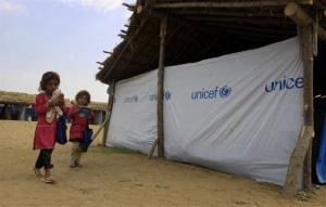 Pakistani girls walk toward their makeshift school set up by UNICEF at Yar Hussain refugee camp in Swabi, Pakistan.