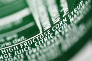 In this Sept. 15, 2011, file photo, high fructose corn syrup is listed as an ingredient on a can of soda.