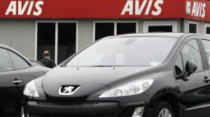 An Avis car rental sign, seen, outside a branch in west London, Monday, Nov. 17, 2008.