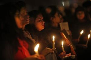 Indians hold a candle light vigil to salute the undying spirit of a rape victim and to mourn her death in New Delhi, India.