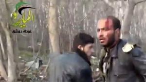 This image from Shaam News Network, authenticated based on its contents and other AP reporting, shows a wounded man at the site of a Syrian government airstrike on a gas station Jan. 2, 2013.