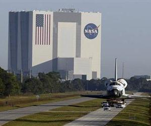 Space shuttle Atlantis make its way from the Vehicle Assembly Building to the Visitor Complex at the Kennedy Space Center, Nov. 2, 2012, in Cape Canaveral, Fla.